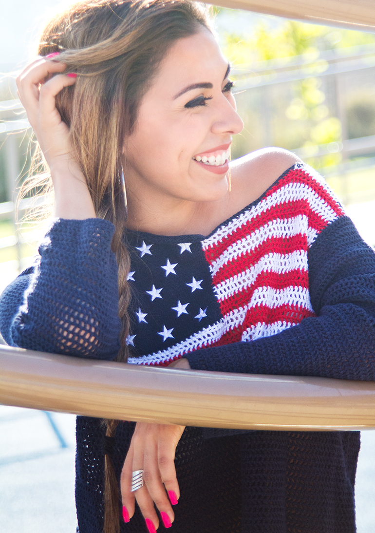 Alexis Alcala Smiling and Wearing a Patriotic American Flag Sweater at the Park on the 4th of July