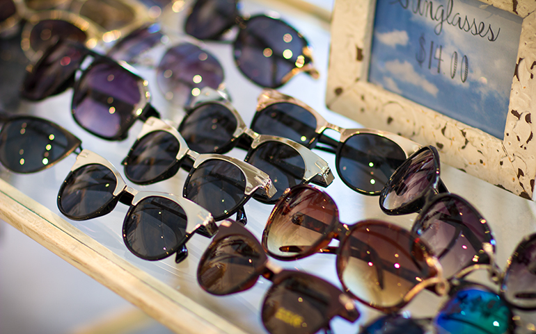 A Closeup Photograph of Sunglasses for Sale in a Boutique Store Next to Art for the Soul in Laguna Beach, California