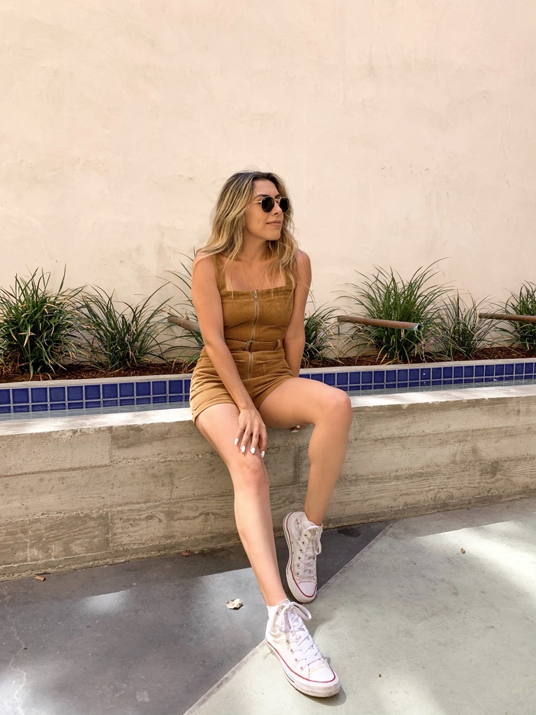 Alexis Alcala wearing a corduroy romper from summer to fall
