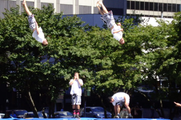 People trampolining at event