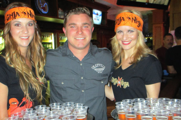 women posing with bartender at event