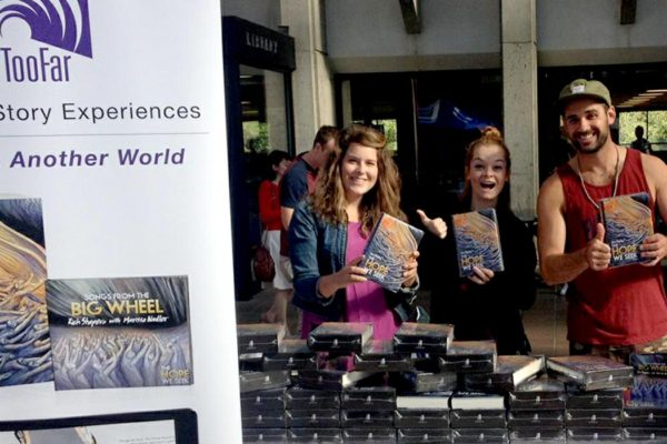 TooFar Event with staff holding books