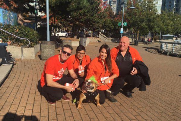 Happy GoFetch Employees Posting with Bulldog -Go Fetch Company Event - Urban Bella Marketing