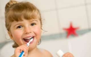 girl child brushing teeth