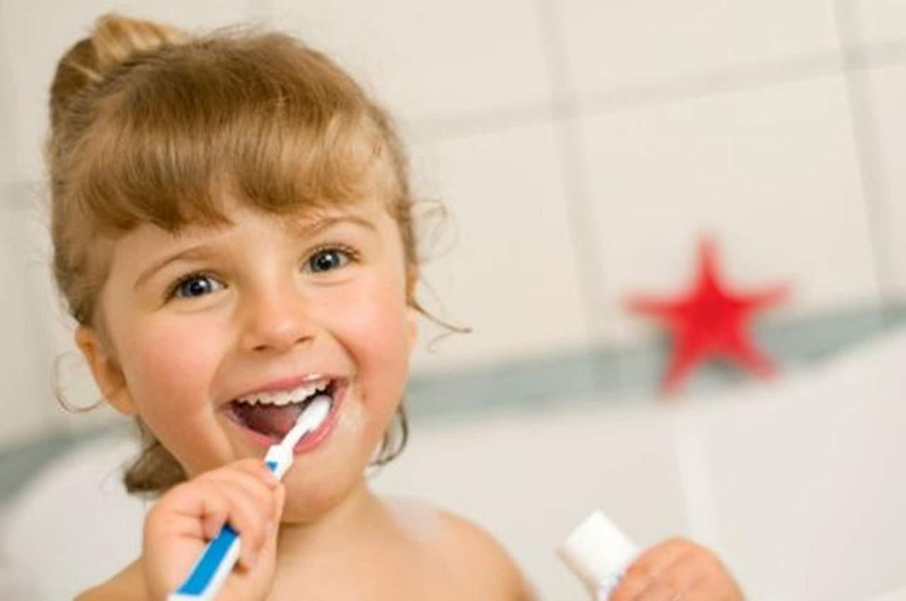 girl child brushing teeth