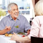 Two people eating at a sestaurant with senior discounts in Oklahoma