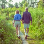 senior couple walking together on a scenic hiking trail