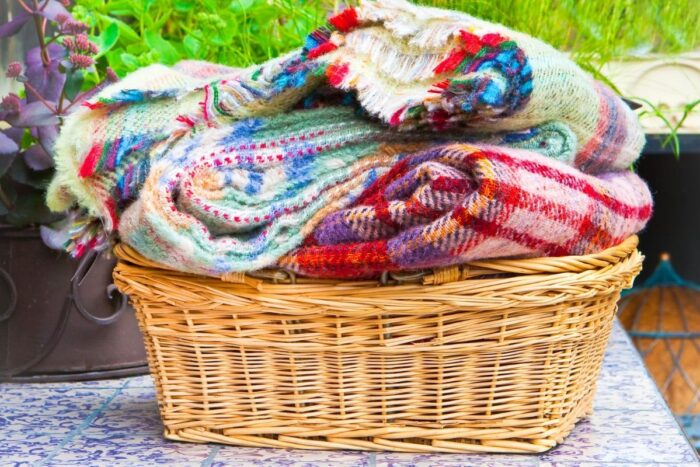 A basket of blankets and scarves