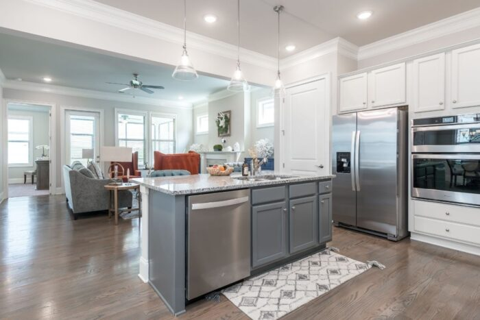 A look inside The Mansions at Gwinnett Park Senior Independent Living villa kitchen and living room.