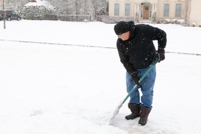 Man shoveling snow in cold weather