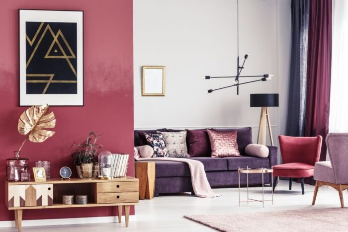 Room decor with warm pink, red, and purple scheme