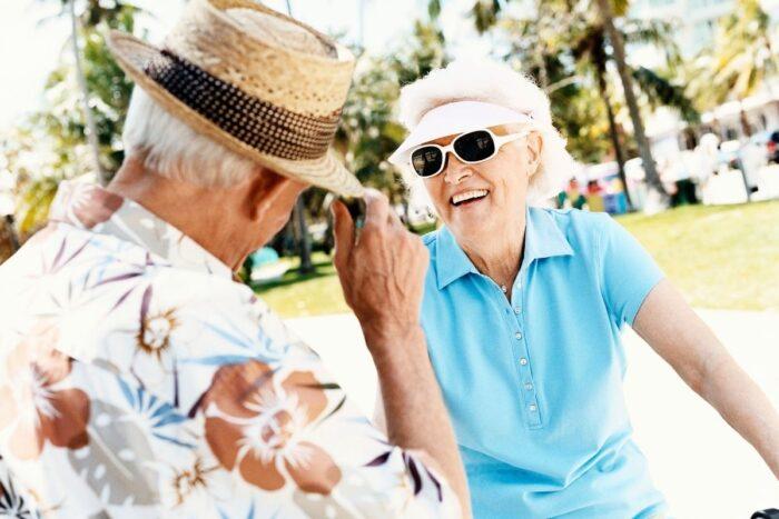 Senior couple having fun in the sun with proper summer attire