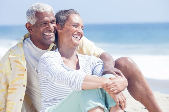 Senior couple relaxing and enjoying the sun at a beach