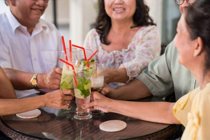 Seniors enjoying drinks together