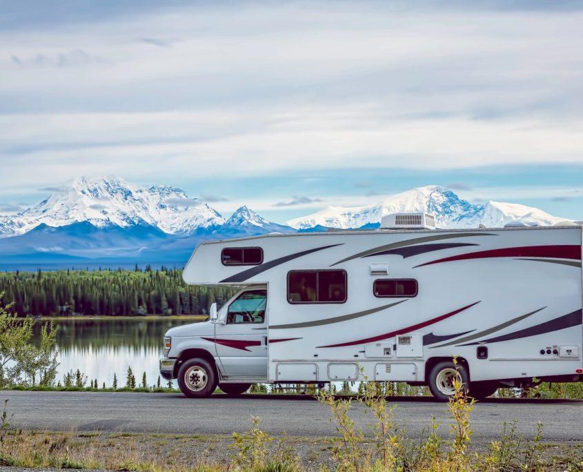 RV with motorhome insurance at mountain lake