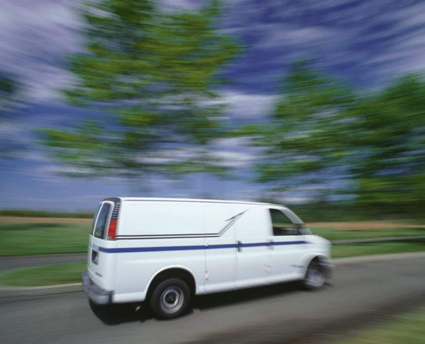 van with commercial auto insurance on road
