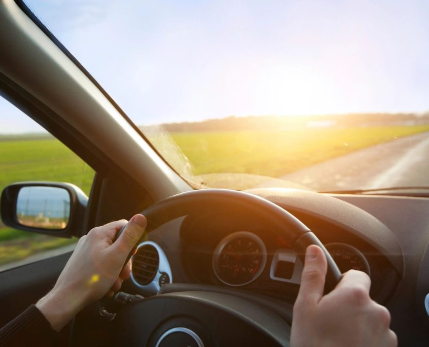 vehicle driving during sunrise