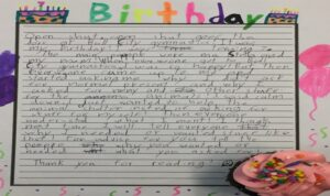students use markers to draw birthday decor