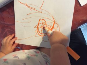 toddlers use markers to color