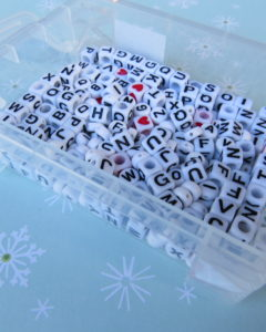 white beads with black letters on them for the candy cane ornament