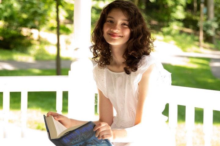 girl holding Harry Potter book