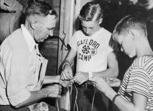 Per G. Lundin (photo left), Michigan assistant state 4-H leader from 1925-1956, instructs 4-H boys in a handicraft project.
