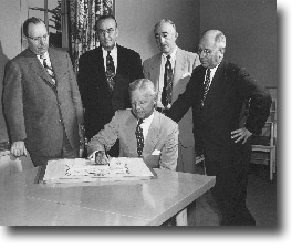 Formation of the Michigan 4-H Foundation was completed in late April of 1952. George Haggarty, Detroit attorney and president of the Michigan 4-H Foundation, is signing the scroll as other incorporators look on. They are, left to right: J.C. Cahill, Detroit, Detroit Edison Company; Milon Grinnell, East Lansing, editor of Michigan Farmer and vice president of the foundation; H.J. Gallagher, Jackson, Consumers Power Company; and A.G. Kettunen, East Lansing, state 4-H club leader and secretary of the foundation. J.H. Alexanian, Lansing, was the sixth incorporator (not pictured).