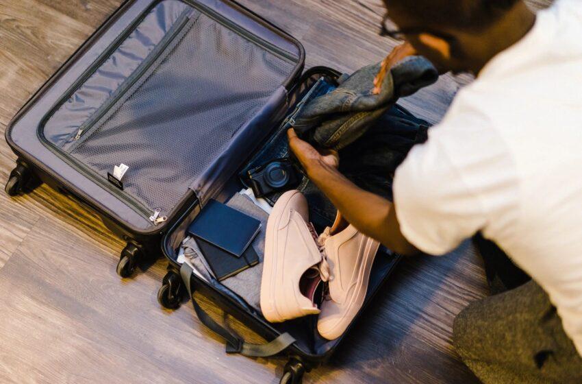 man packing suitcase