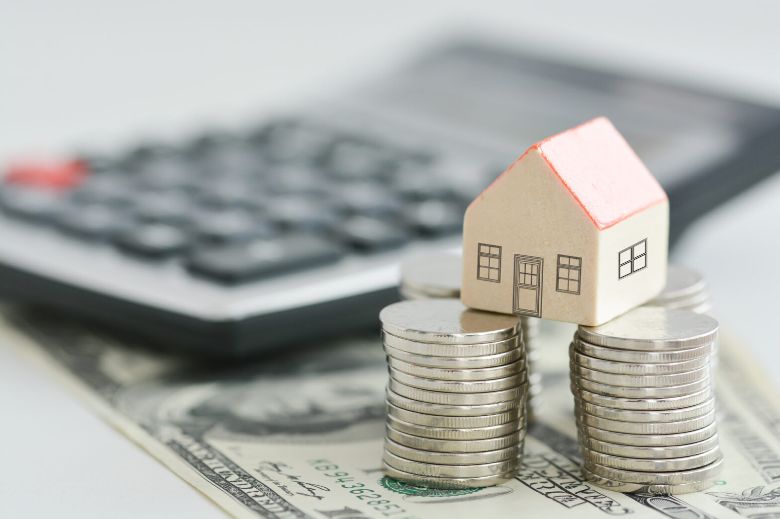 House on money pillars suggesting property investment
