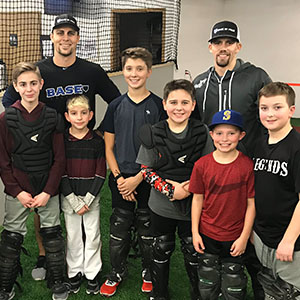 Coach Mitch and Coach Joel with students at a catching clinic