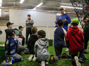 Coach Kai talks with players at his first BASE by Pros camp on Dec. 9, 2017.