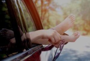Healthy feet out car window