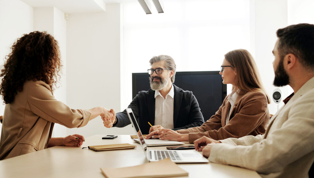 professionals meeting around conference table