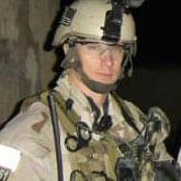 A soldier in full gear