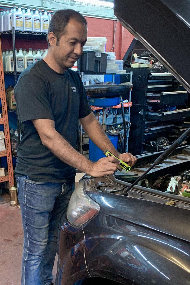 Owner Jay Operating Car Lift