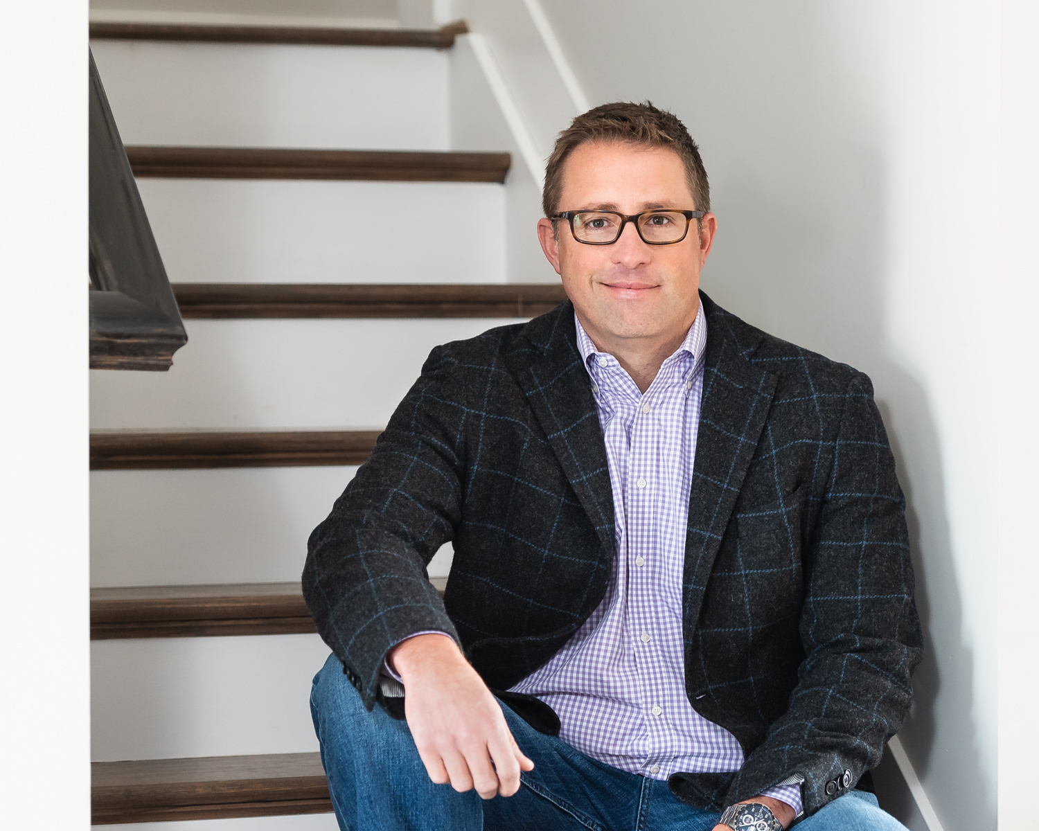 Cincinnati Custom Home Building Company WP Land CEO Mat Walker sits on the newly constructed stairs at the newest WP Land market house in Kensington of Mason in Deerfield Township, Cincinnati, OH.