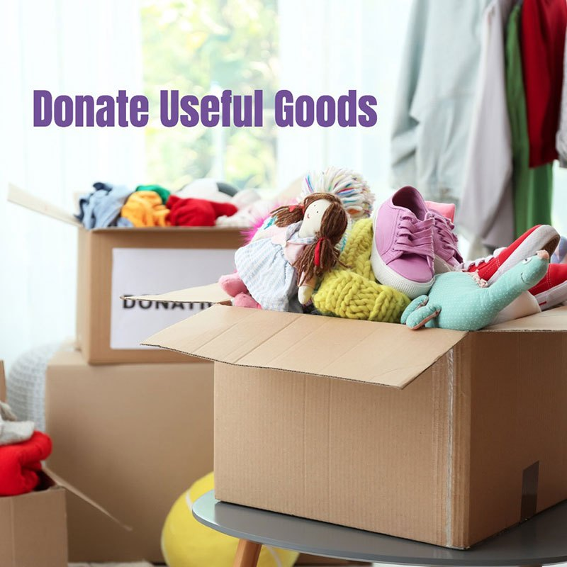 donation-box-with-clothes-and-toys-on-table-indoors-space-for-text-picture-id1132987331