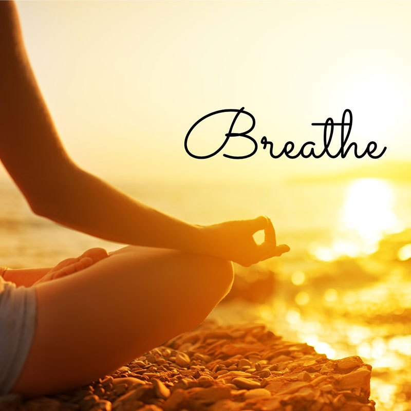 hand-of-woman-meditating-in-a-yoga-pose-on-beach-picture-id467432069