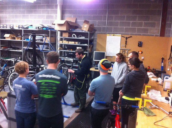 Alex Beld of Expeditions at UW-Oshkosh demonstrating a bicycle tune-up.