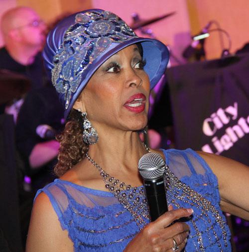 Danita Johnson Hughes wearing hat speaking