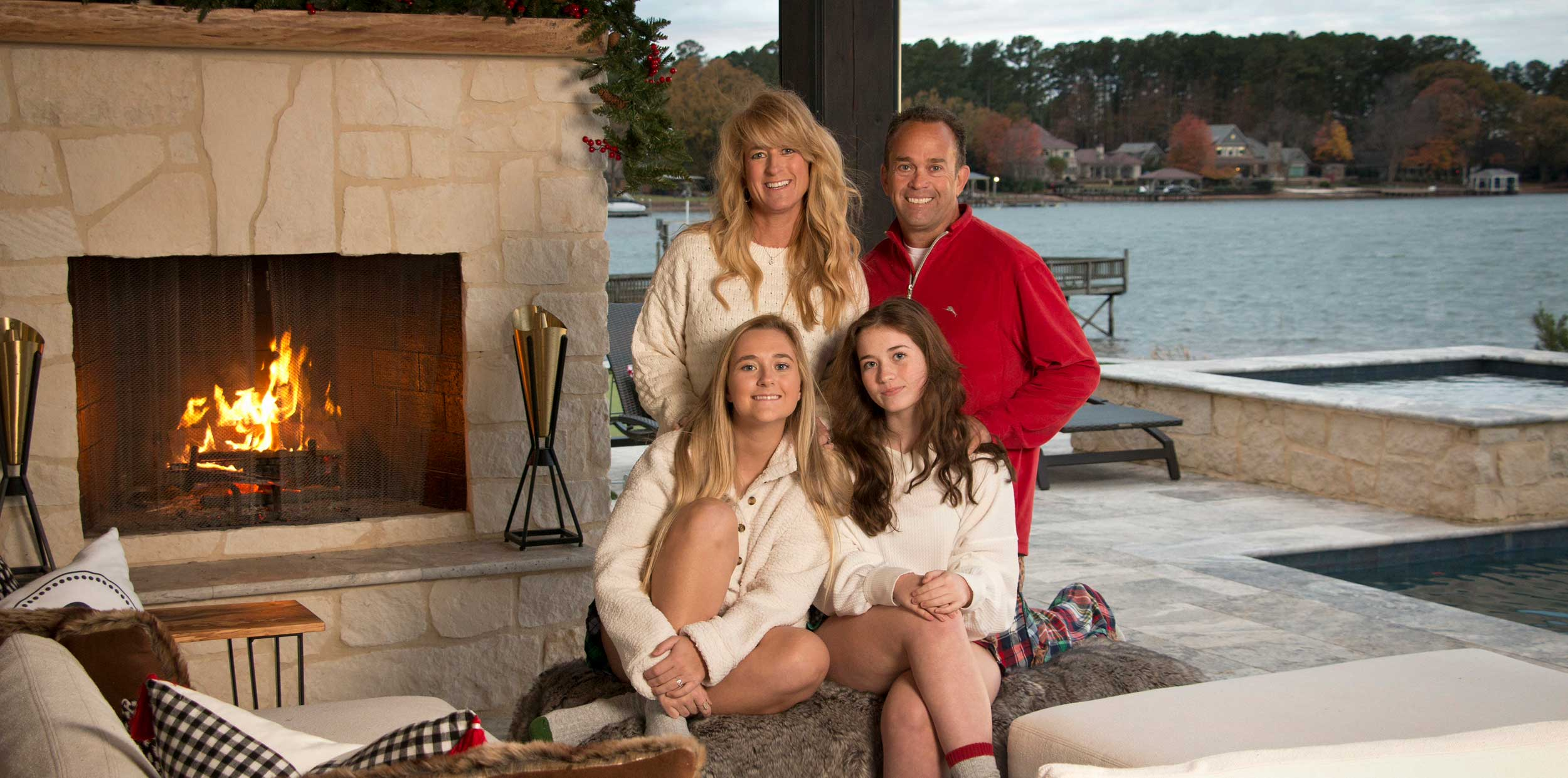 Family in front of fireplace on patio at Lake Norman, NC