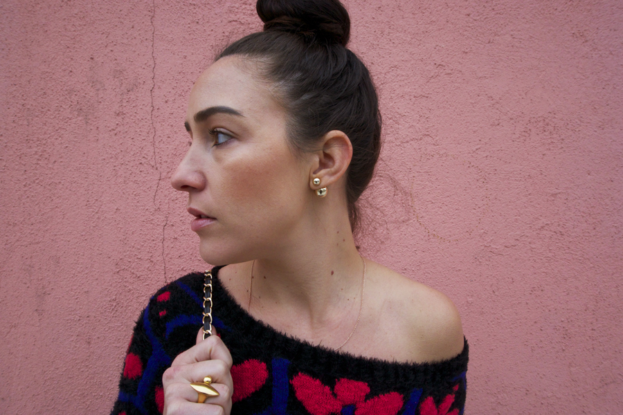 gold earrings gold ring pink wall