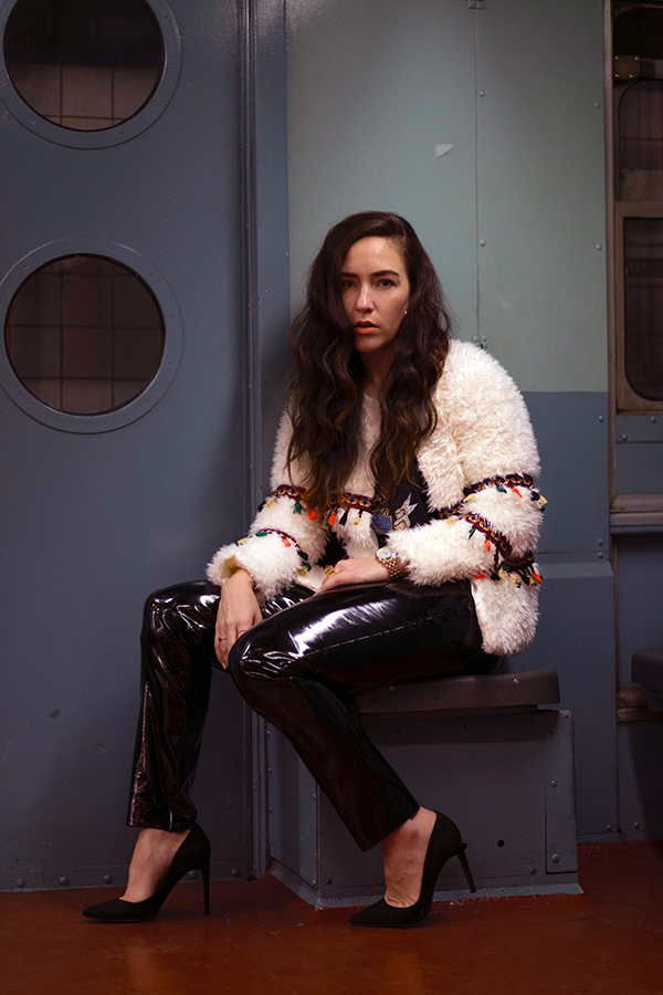 patent-leather-pants-cream-shaggy-coat-with-tassels-22