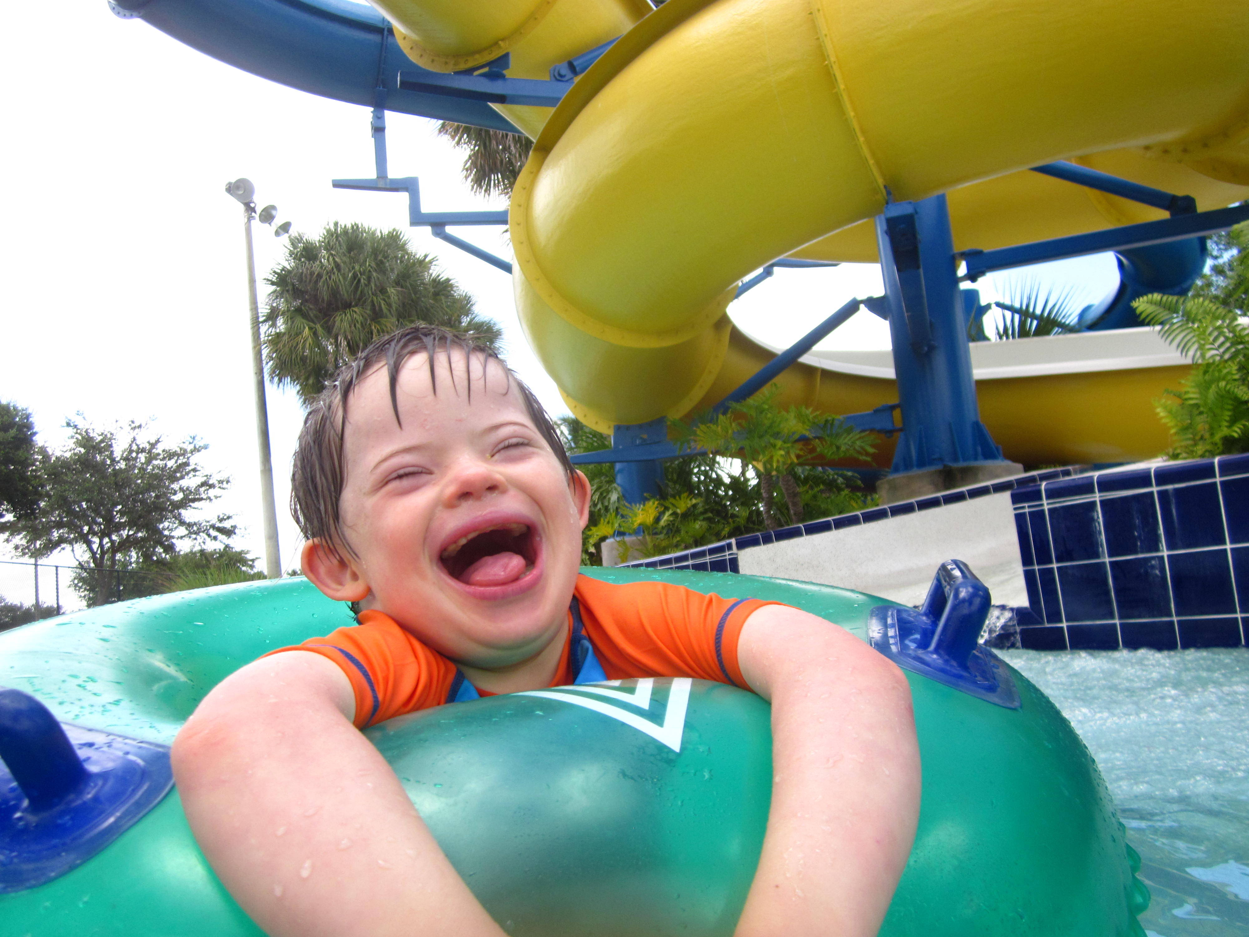 Child smiling at a waterpark