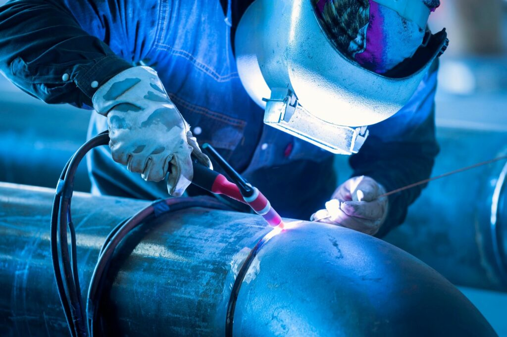 Welder welding pipe using certified welding methods