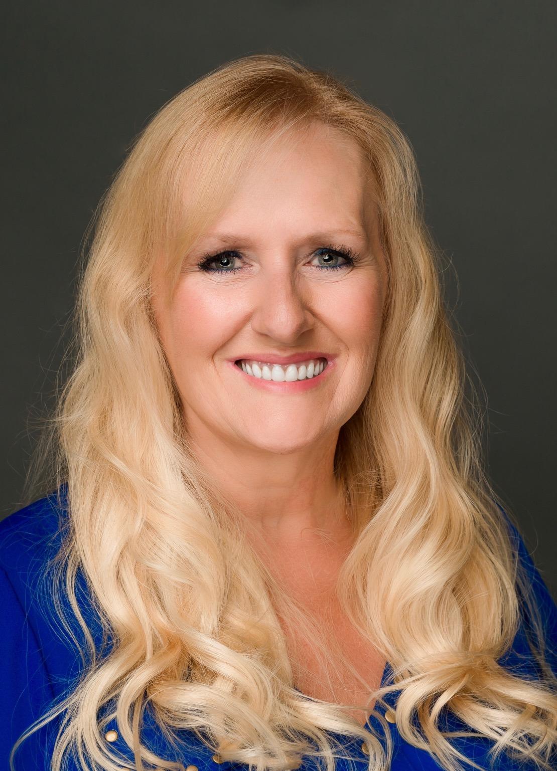 Kelly E. Professional Head shot 2019