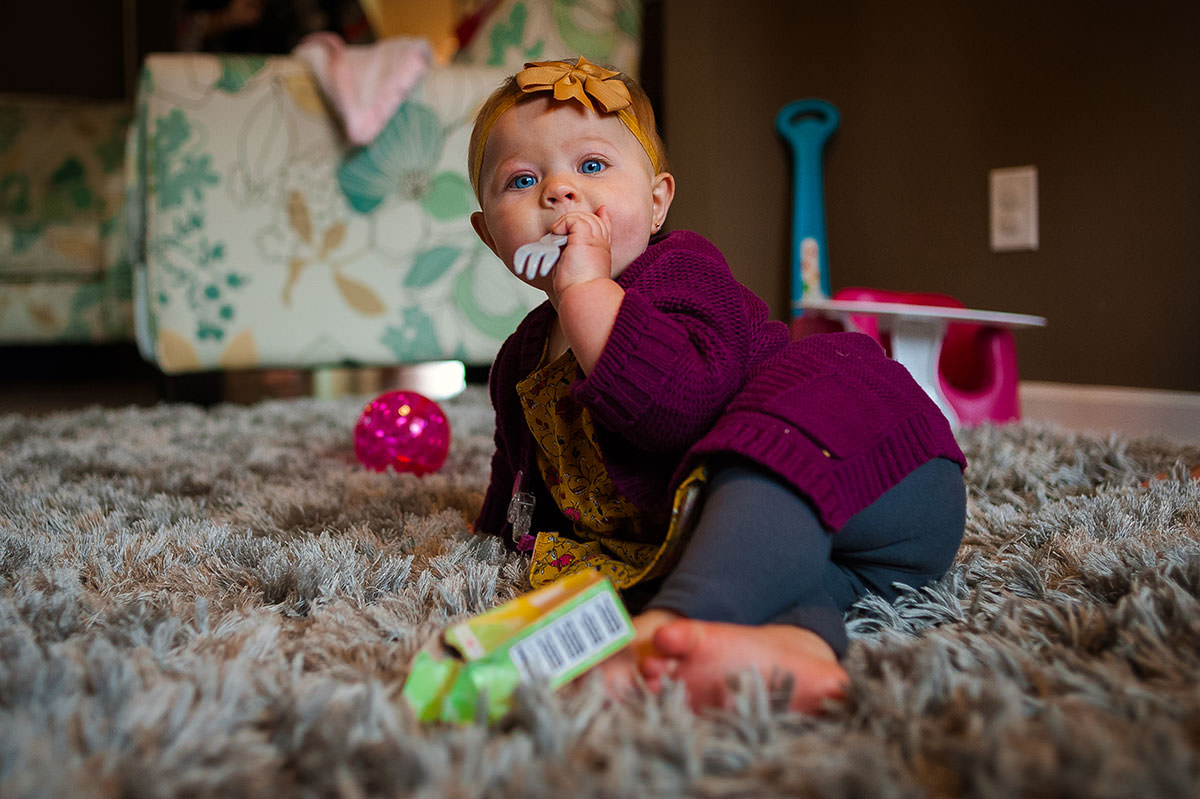 baby girl with form in mouth