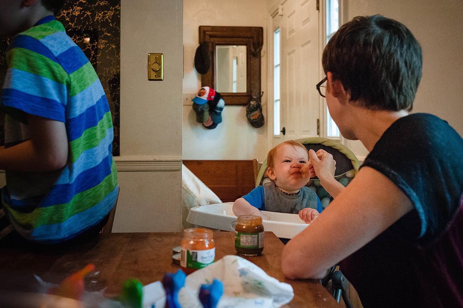 mom feeding son baby food