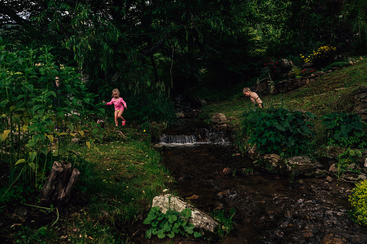 boy and girl playing creek
