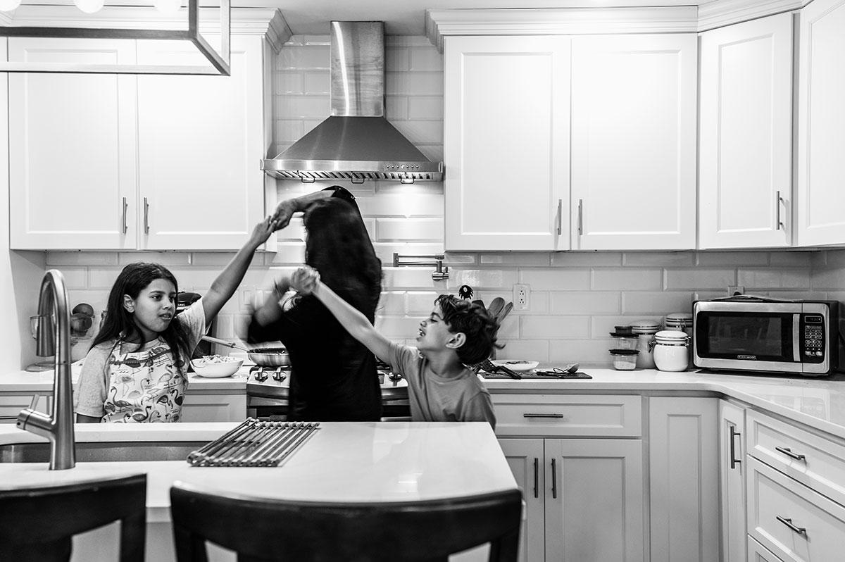 Sharon, Lyla and Rhyse dance in the kitchen